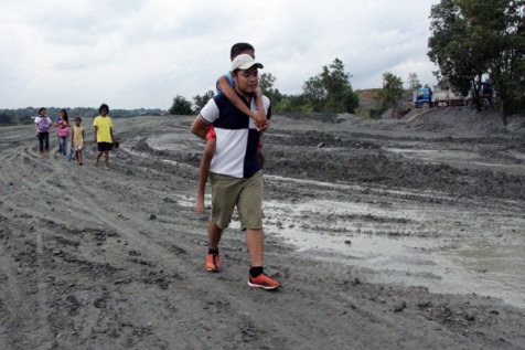 Tristan John Cabrera, Unbound's communications liaison in the Philippines, takes a turn carrying Virgilio on a visit to town.