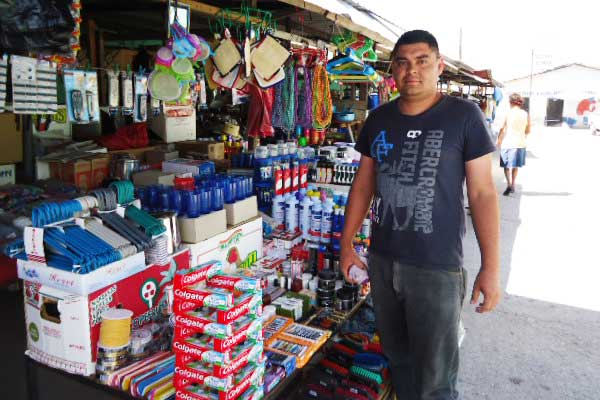 Francisco at his stall in the local marketplace.