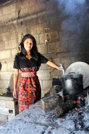 : Ingrid helps her mother by cooking food to sell as the main source of income for the family.