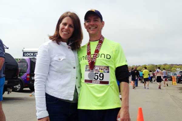Unbound Trailblazer David Scarpello with his wife, Jennifer, after completing the 2015 Twin Lights half marathon in Gloucester, Mass.