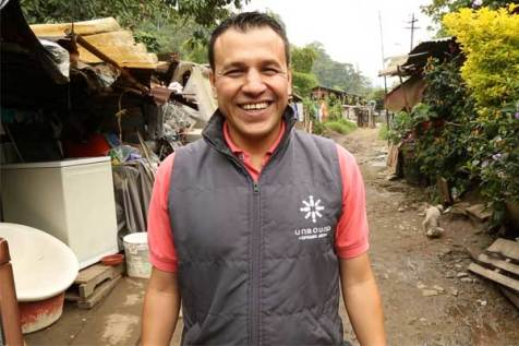 John Fredy Arango, an Unbound staff member in Medellin, Colombia, walks though one of the neighborhoods he serves.