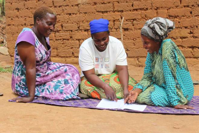 Image = From left: Annet, Sarah and Joyce, members of the Unbound mothers group who supported and cared for Jonah while his mother was away working.