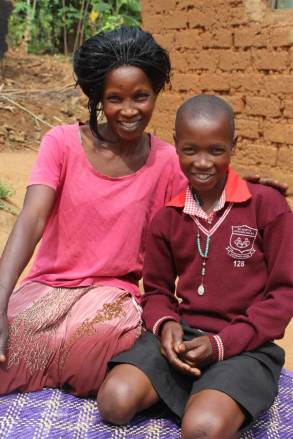 Image = Jane and her son, Jonah, who is sponsored through Unbound and has been cared for by many other mothers in the community.