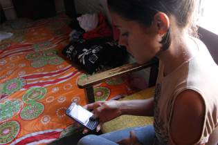 An image of a woman checking her cell phone.