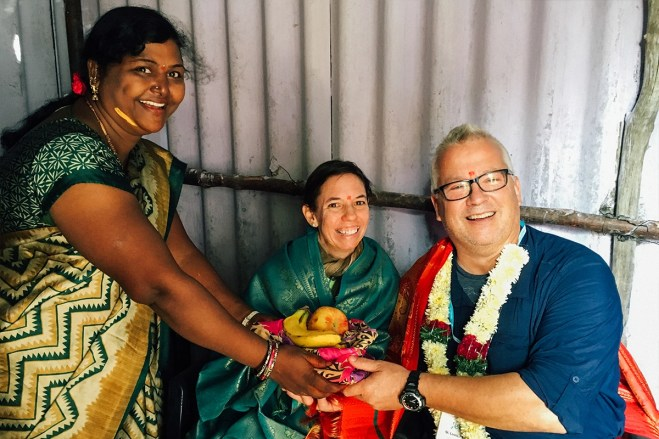 Sravanthi's mother presents the couple with a basket of fruit.