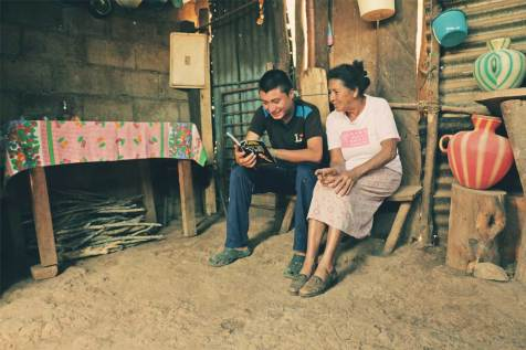 Sponsored elder Teresa, in Guatemala, takes care of her grandson Luis. In the evenings, Luis reads to his grandmother. It is a special moment of sharing for both of them.