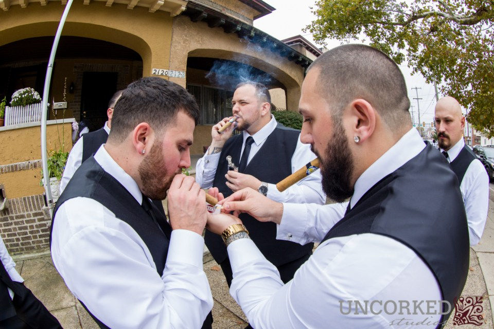 Groomsmen sharing a cigar