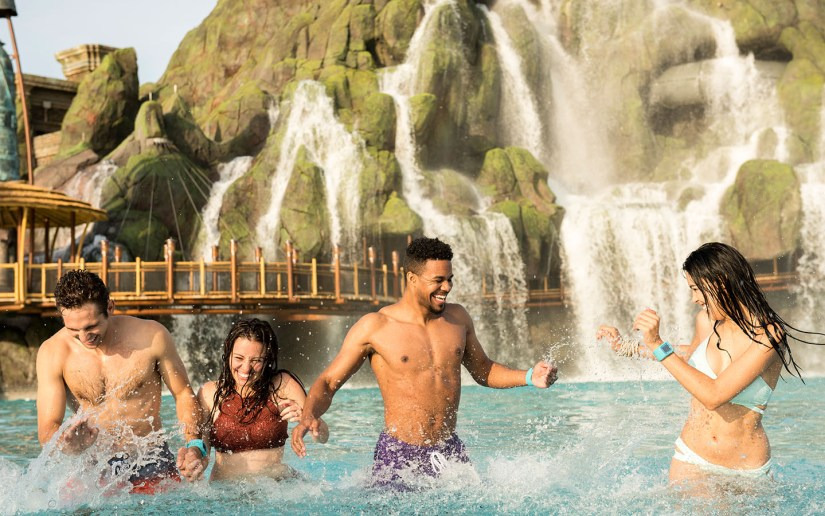 Enjoy the waves in the Waturi Pool at Universal's Volcano Bay.