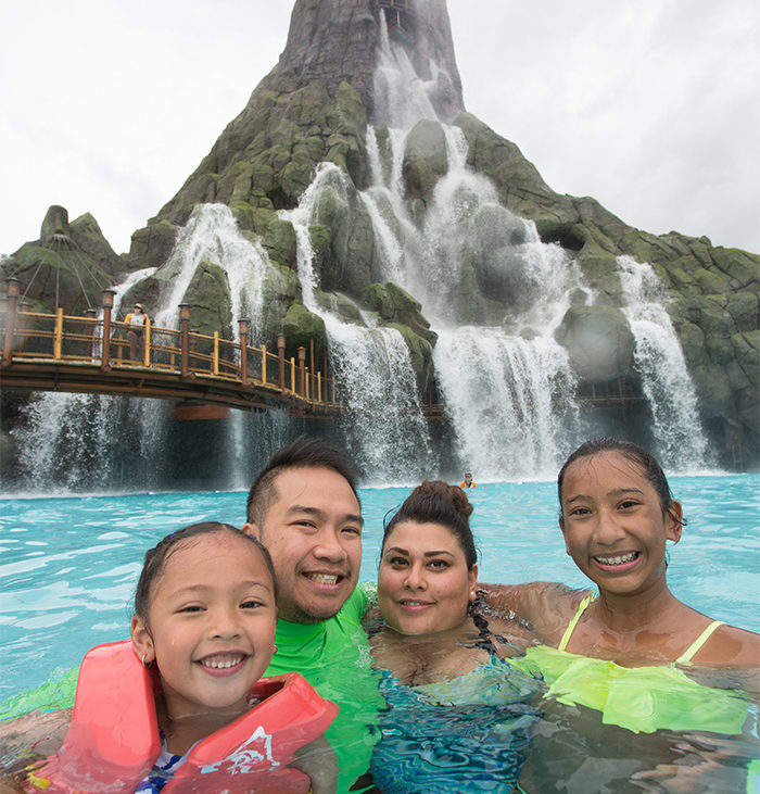 Family fun in the wave pool at Universal's Volcano Bay