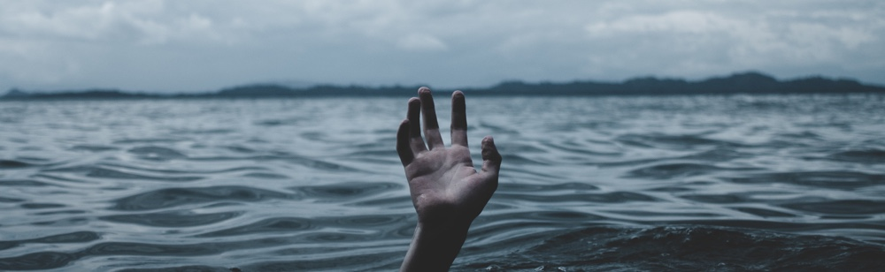 Giving up too soon. hand in the sea