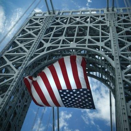 USA flag in the wind on George Washington Bridge