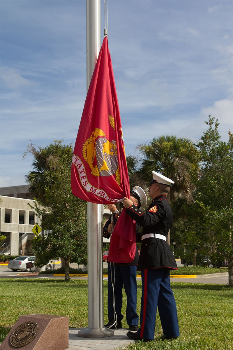 US Marines raising the Marine Corps flag during a ceremony at the Veterans Day Tribute and a Veterans Plaza Dedication in Jacksonville.