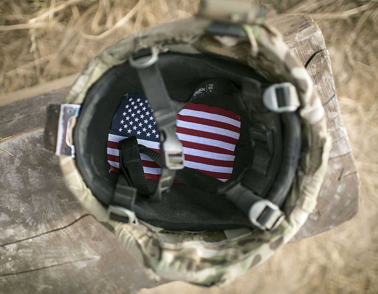 An American flag lines the inside of a U.S. Soldier's helmet at Forward Operating Base Azim Jan Karez in Kandahar, Afghanistan.