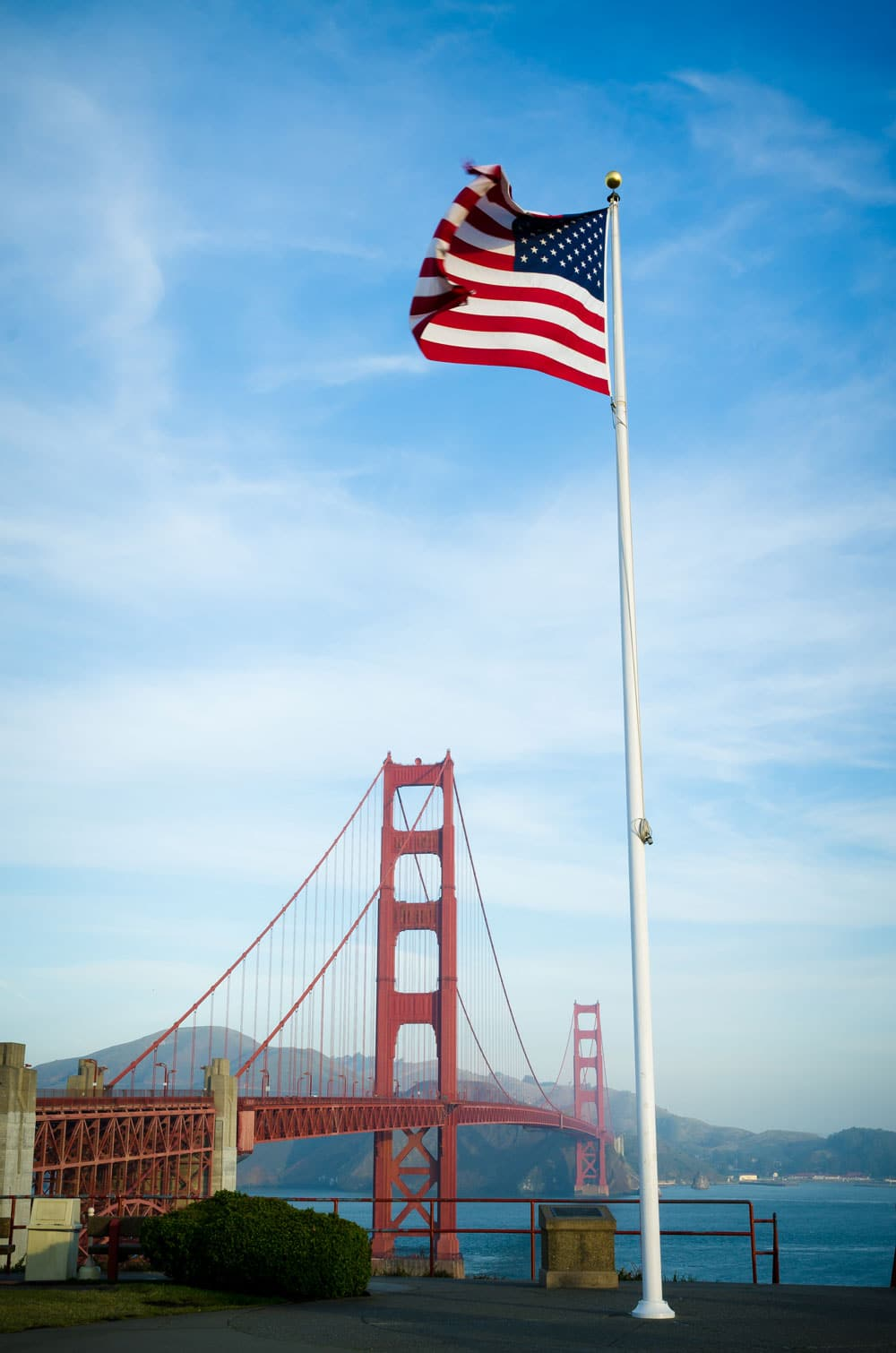 Golden Gate Bridge in San Francisco California and US flag.