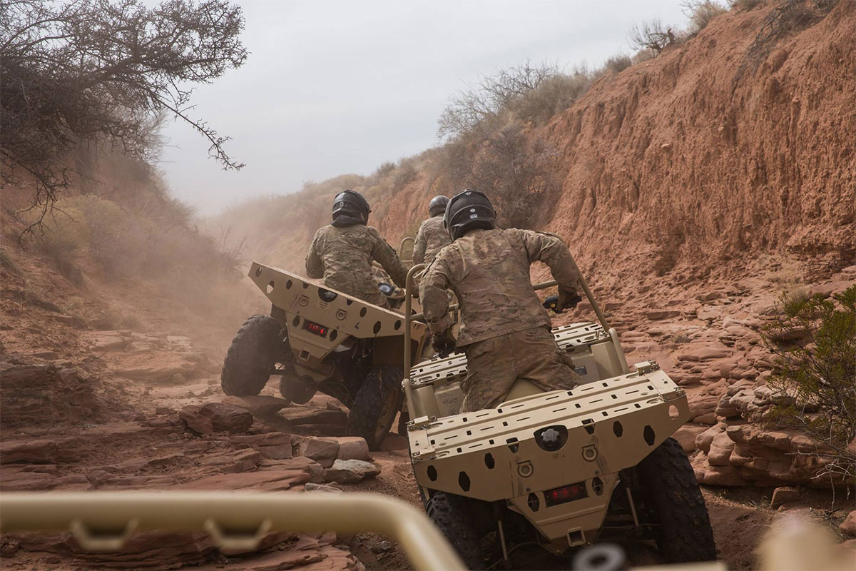 U.S. Army Green berets assigned to 3rd Special Forces Group (Airborne) practice off-road driving in New Mexico.