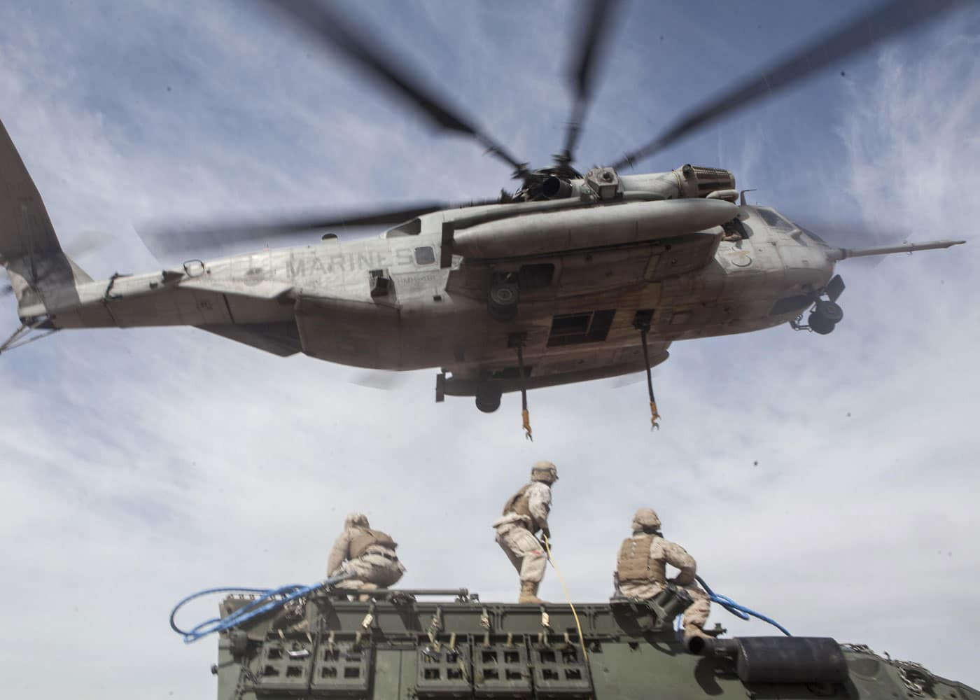 A U.S. Marine Corps CH-53E Super Stallion assigned to Marine Aviation Weapons and Tactics Squadron One lifts a Humvee during a CH-53 tactics exercise at Auxiliary Airfield 2, Yuma, Arizona.