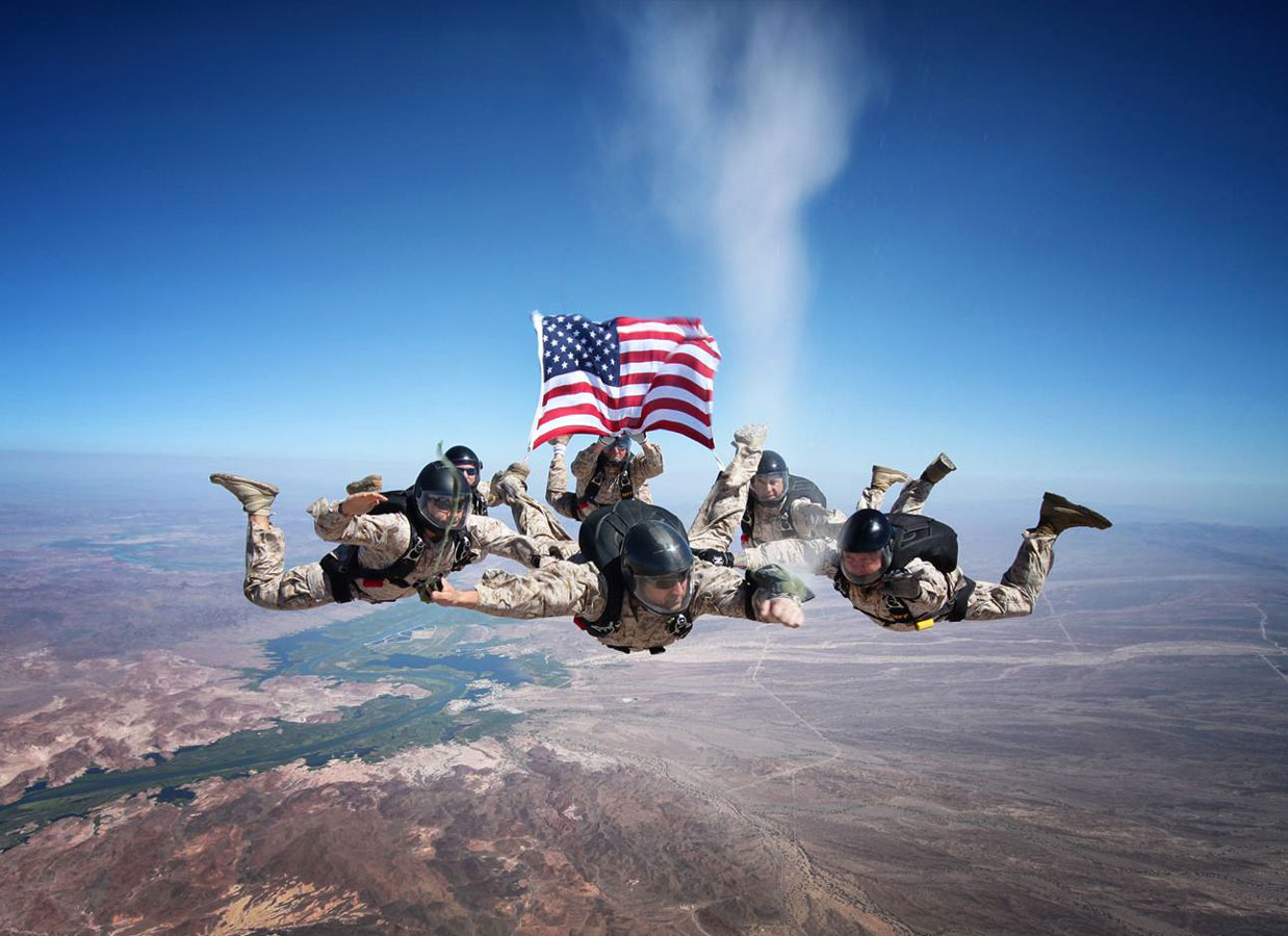 """Air Force Staff Sgt. Johnny Gunn. Gunn took this photo of Marine free fall instructors spreading the ashes of Sgt. Brett Jaffe over the Phillips Drop Zone at Yuma Proving Grounds, Ariz., in keeping with his final request. """"This was a memorial ash release dive, by Marines, for a Marine, at the request of a Marine wife,"""" Gunn said. """"I ... was honored to be asked to do this. It gave me goose bumps taking it, and still does every time I see it!"""""""