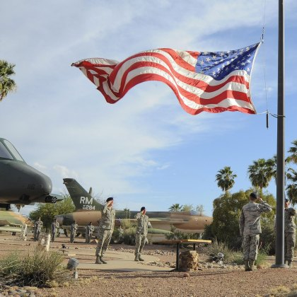 Airmen from the 355th Security Forces Squadron lower the American flag during a retreat ceremony for National Police Week at Davis-Monthan Air Force Base, Arizona.