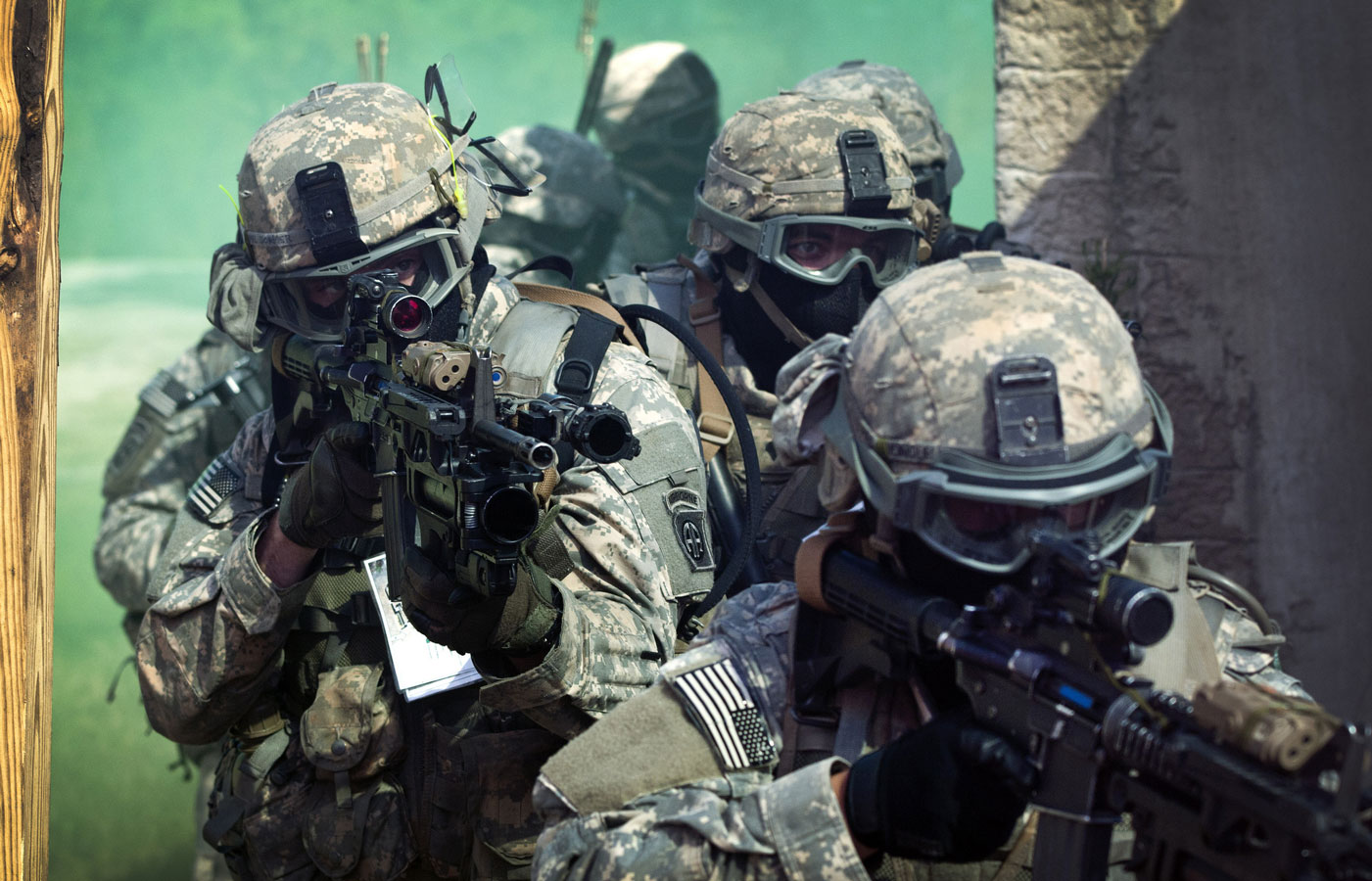 Paratroopers assigned to 1st Battalion, 508th Parachute Infantry Regiment, 4th Brigade Combat Team, 82nd Airborne Division, prepare to enter a building as they conduct close quarters combat training during an air assault mission, Sept. 26.