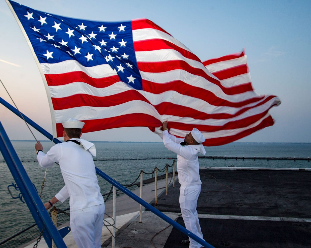 U.S. Navy Sailors assigned to the color guard aboard the aircraft carrier USS Dwight D. Eisenhower (CVN 69) retire the colors.