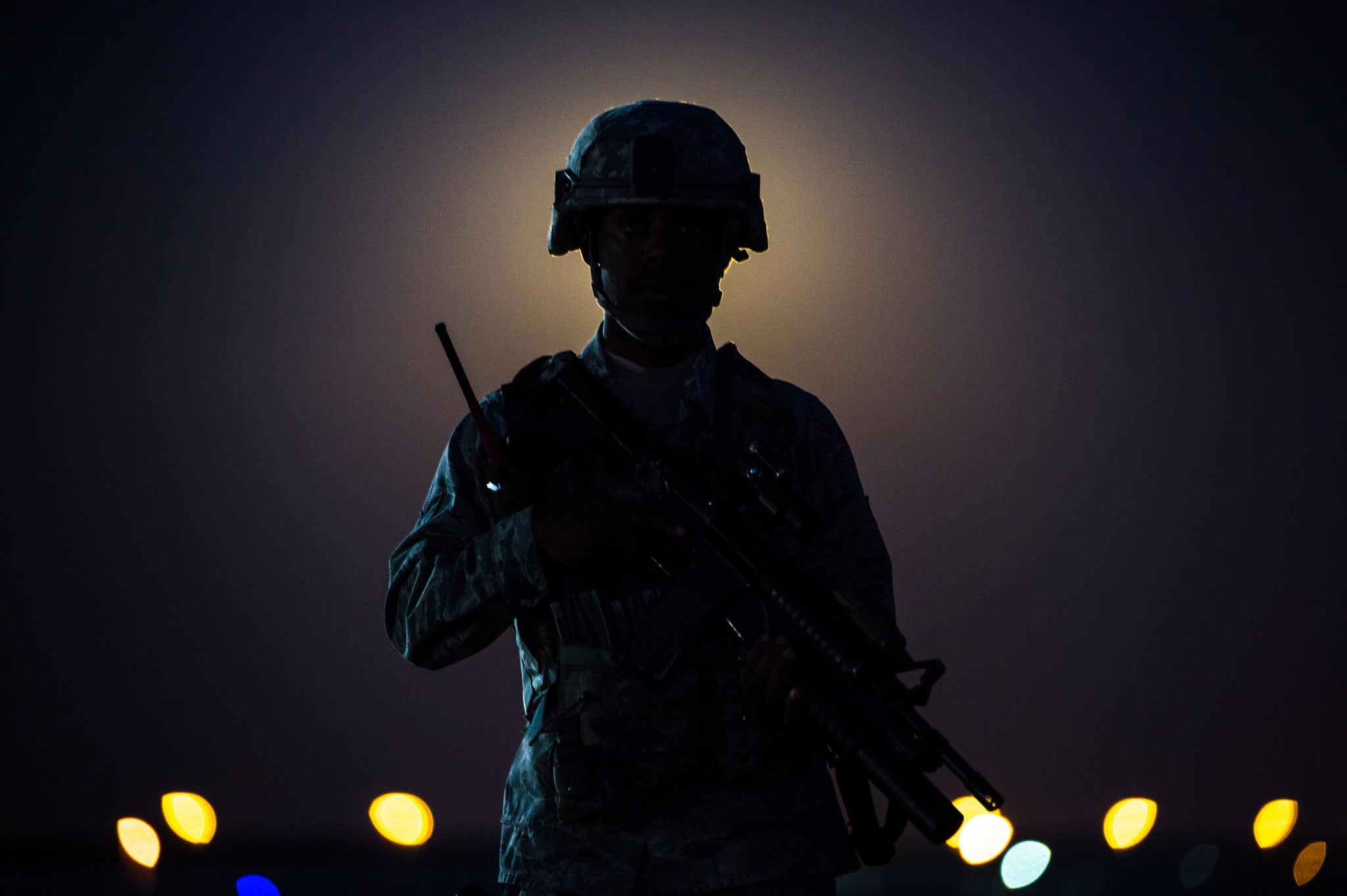 A member of the 380th Air Expeditionary Wing security forces stands on a flight line near a guard tower at an undisclosed location in Southwest Asia, Nov. 14, 2016. Behind the Airman a rare Supermoon rises in the sky. The moon has not been closer to the Earth since Jan. 26, 1948.