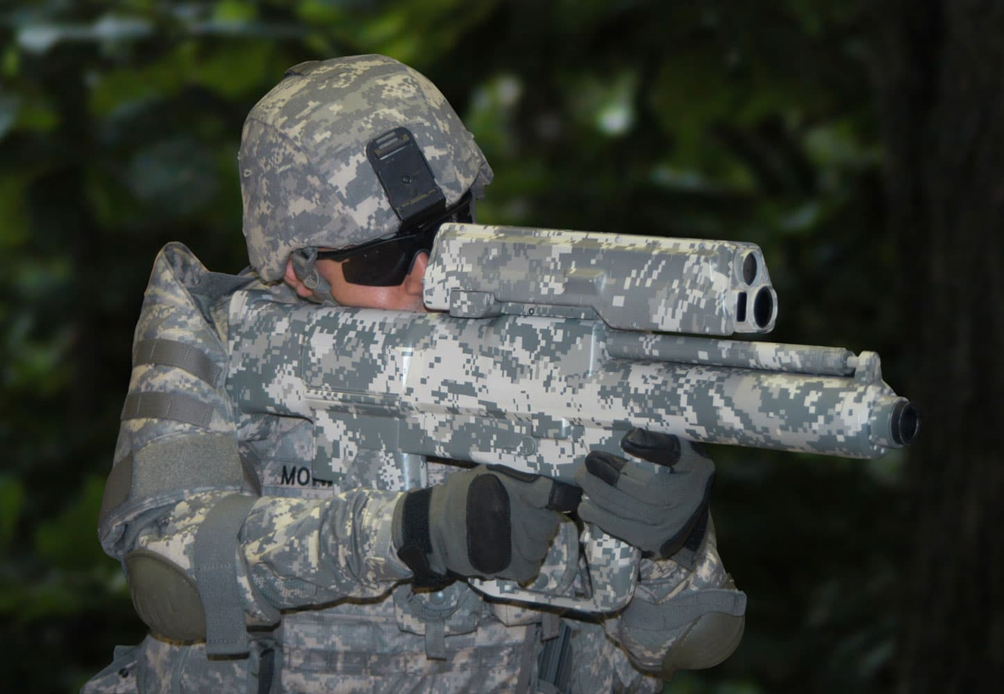 """The XM-25 Counter Defilade Target Engagement System is the Army's first """"smart"""" shoulder-fired weapon. It launches 25mm dual-warhead, low velocity, flat trajectory ammunition designed to explode over a target. PEO Soldier unveils lighter, more lethal weapons systems."""