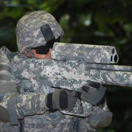 "The XM-25 Counter Defilade Target Engagement System is the Army's first ""smart"" shoulder-fired weapon. It launches 25mm dual-warhead, low velocity, flat trajectory ammunition designed to explode over a target. PEO Soldier unveils lighter, more lethal weapons systems."