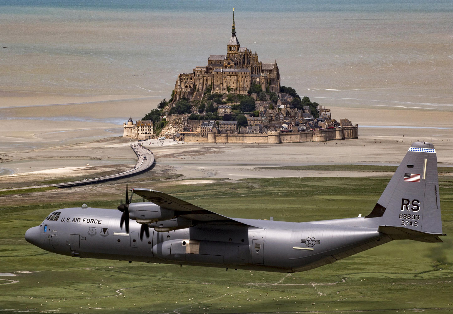 Air Force Brig. Gen. Richard G. Moore Jr. flies a C-130J Super Hercules past Mont Saint-Michel in Normandy, France, June 3, 2017, during an event commemorating the 73rd anniversary of D-Day.