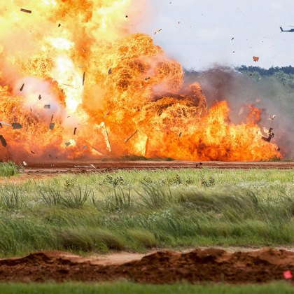"Paratroopers of the 82nd Airborne Division detonate explosives during an airborne review at Sicily Drop Zone, Fort Bragg N.C., May 25, 2017. The airborne review is the culminating event of All American Week 100, which is an opportunity for Paratroopers past and present to celebrate being members of the All American Division. This year's theme is,""Celebrating a Century of Service!"""