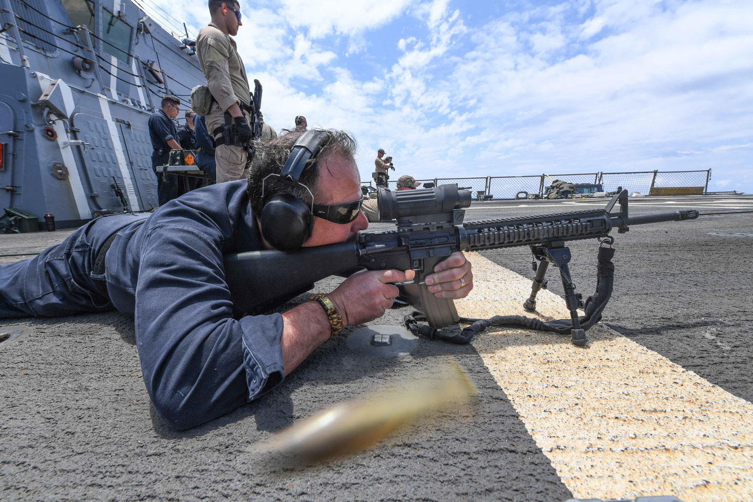 Gunner's Mate 1st Class Christopher Paul fires an M4A1 carbine on the flight deck of the Arleigh Burke-class guided-missile destroyer USS James E. Williams. James E. Williams, home-ported in Norfolk, Virginia, is on a routine deployment to the U.S. 6th Fleet area of operations in support of U.S. national security interests in Europe.