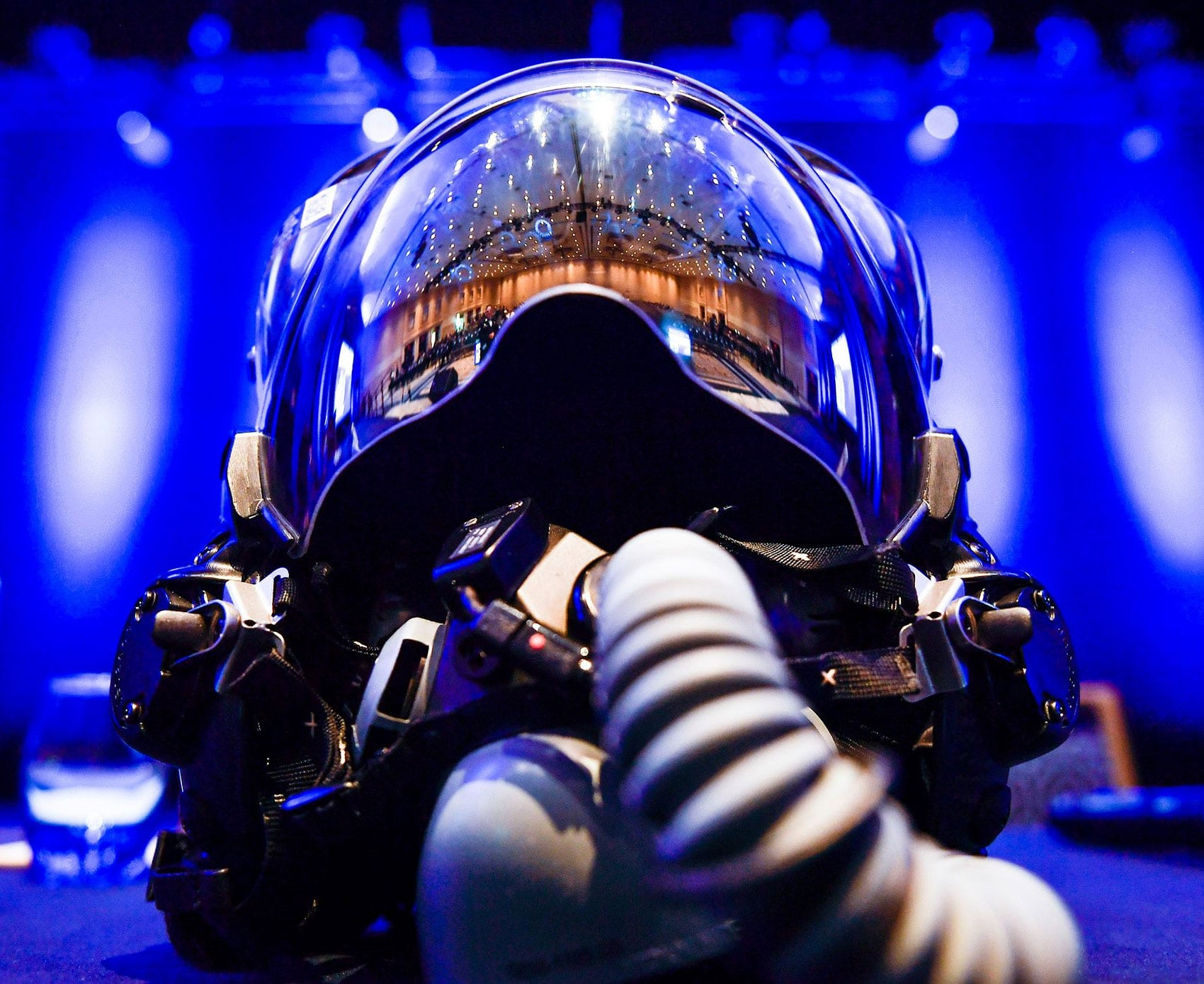 An F-35 Lightning II helmet sits on stage during the F-35 reaching initial operational capability panel discussion during the Air Force Association's Air, Space and Cyber Conference in National Harbor, MD.