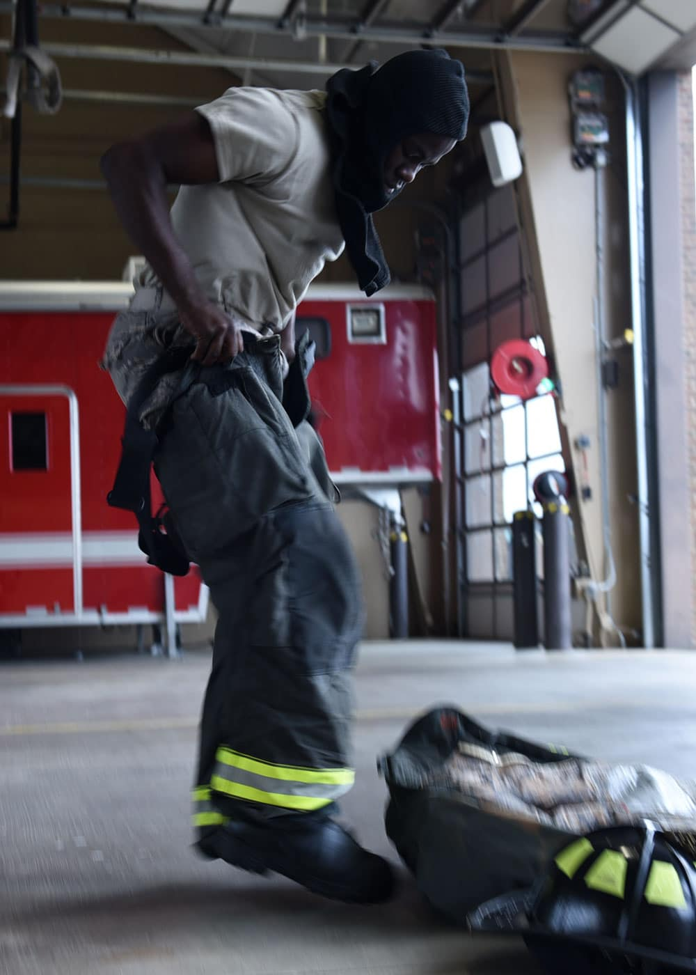 U.S. Air Force Airman 1st Class Tevado Beckford Fire Protection apprentice, dons his fire gear in 39 seconds. The 19th CES Fire Department firefighters respond to fires or emergency situations on base at a moment's notice.
