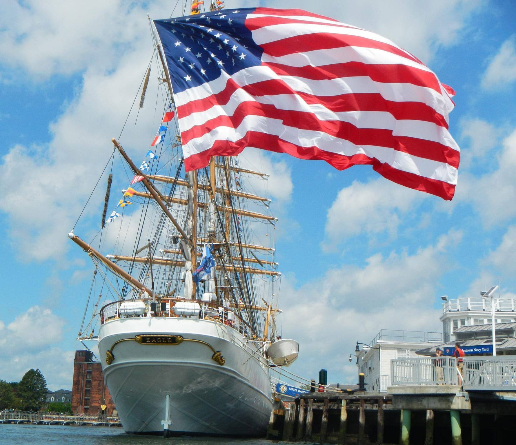 USCG fan Elizabeth Burgess shared this beautiful photo of Old Glory flying high and proud from the stern of United States Coast Guard Barque EAGLE in Boston during SailBoston.