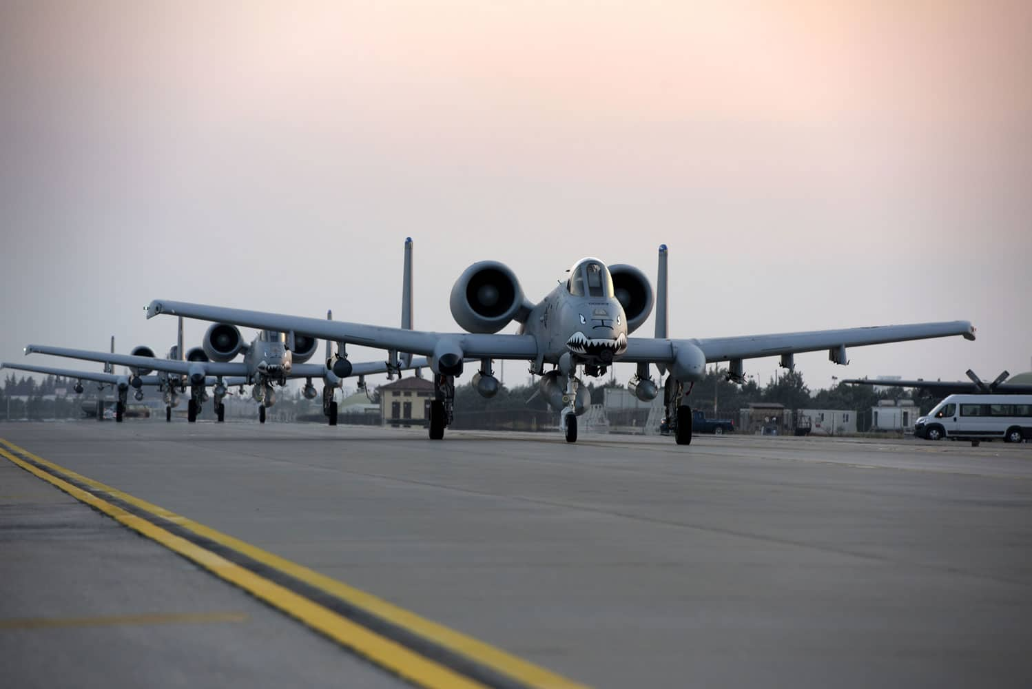 Three U.S. Air Force A-10 Thunderbolt II's taxi along the flight-line at Incirlik Air Base, Turkey.