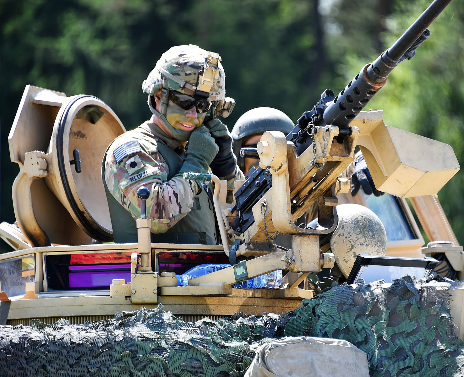 Army Lt. Col. Jonathan Kluck, commander, 4th Infantry Division's 1st Battalion, 68th Armor Regiment, 3rd Armored Brigade Combat Team, prepares to dismount his M1A2 Abrams tank after participating in a combined arms live-fire exercise at the 7th Army Training Command's Grafenwoehr Training Area in Germany.