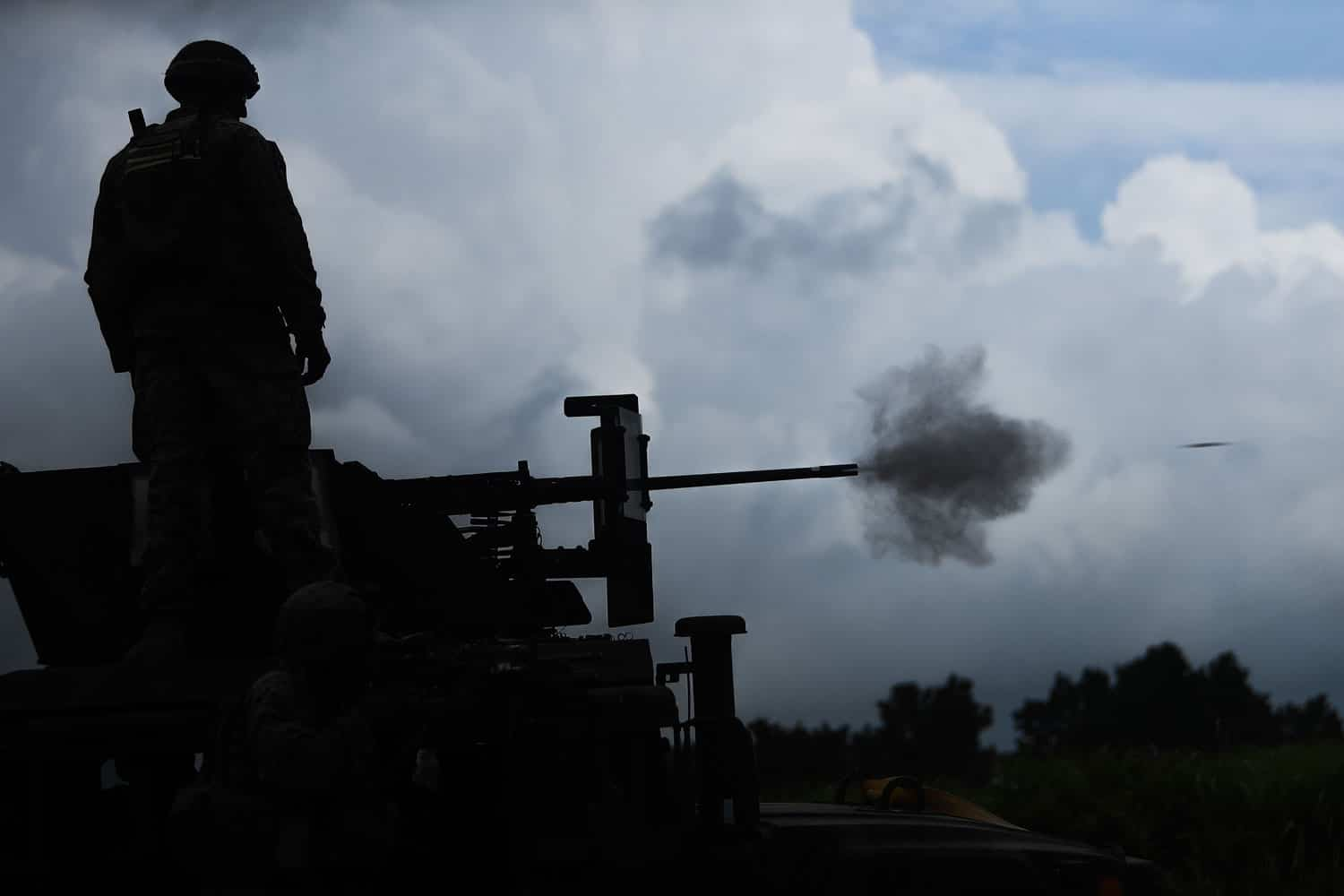 Cpl. William D. Alexander, a Severn, Maryland native and anti-tank missile-man with Combined Anti-Armor Team 2, Weapons Company, 1st Battalion, 3rd Marine Regiment, observes a mounted M2 .50 caliber machine gun fire down range during Exercise Fuji Viper.