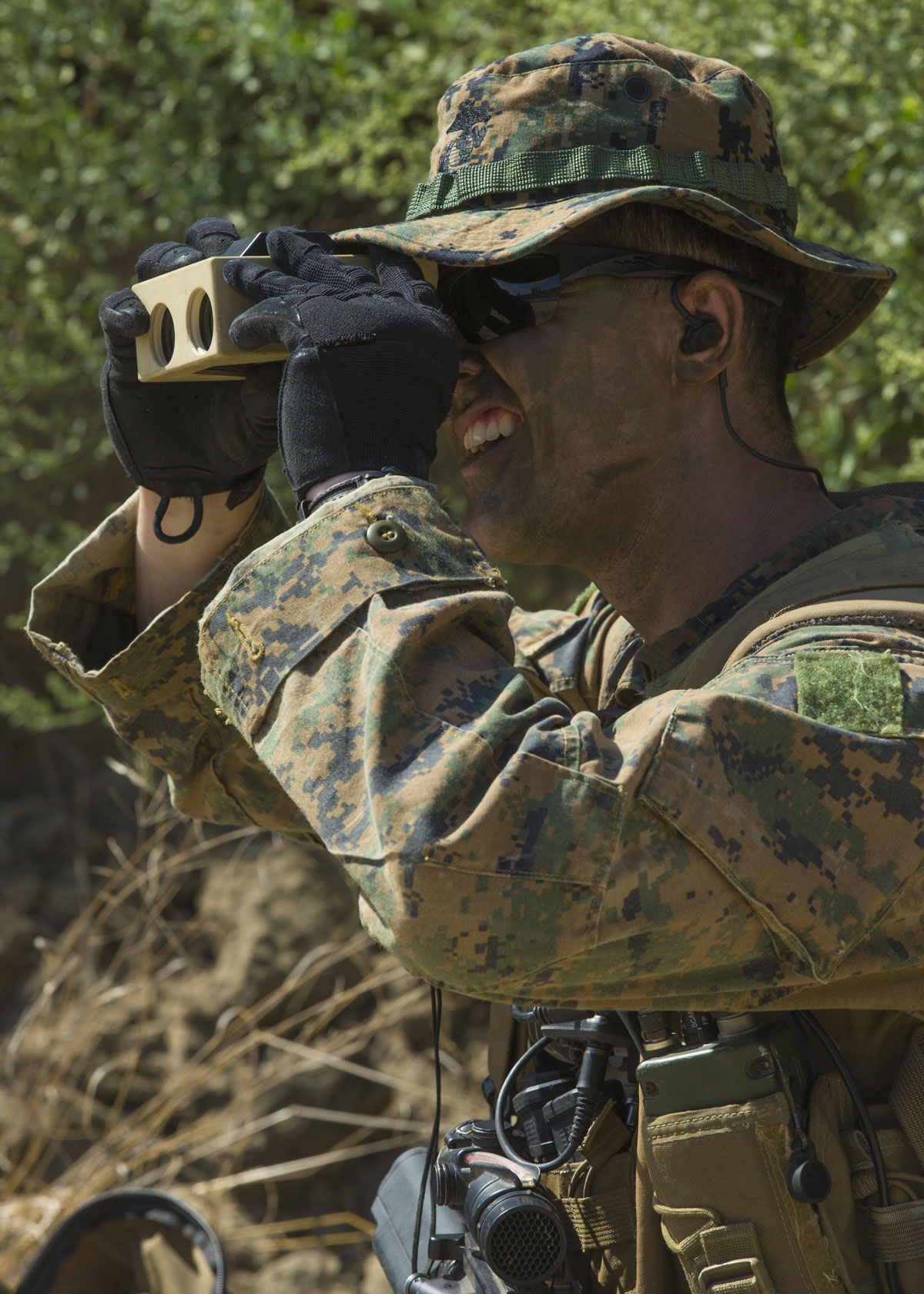 US Marine Corps Captian Zachariah Riley, an Artillery Officer, scouts for enemy contact during a simulated reconnaissance mission on Camp Pendleton, California.