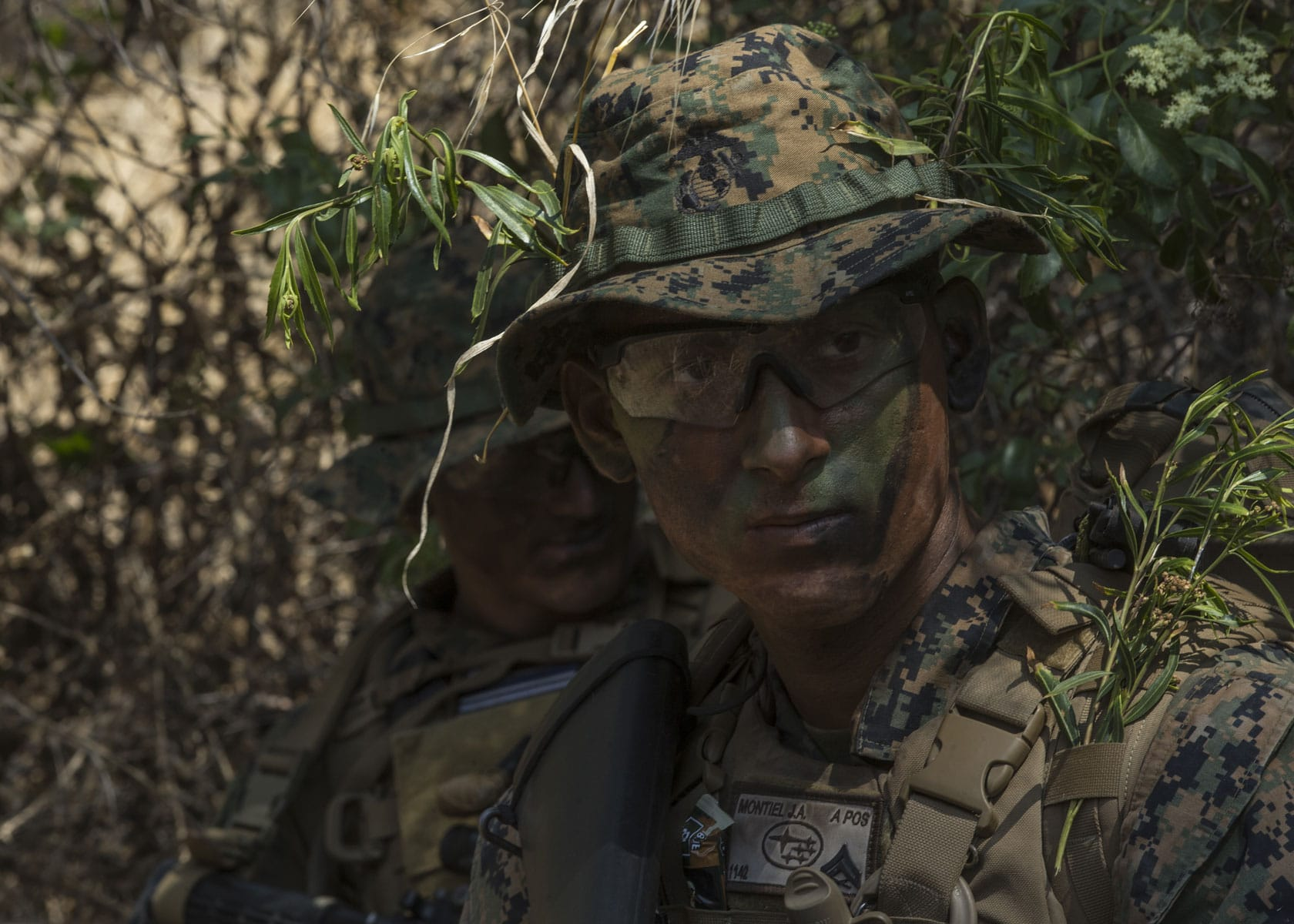 Marine Corps Cpl. Jelmer Montiel, a Generator Mechanic, takes cover during a simulated reconnaissance mission.