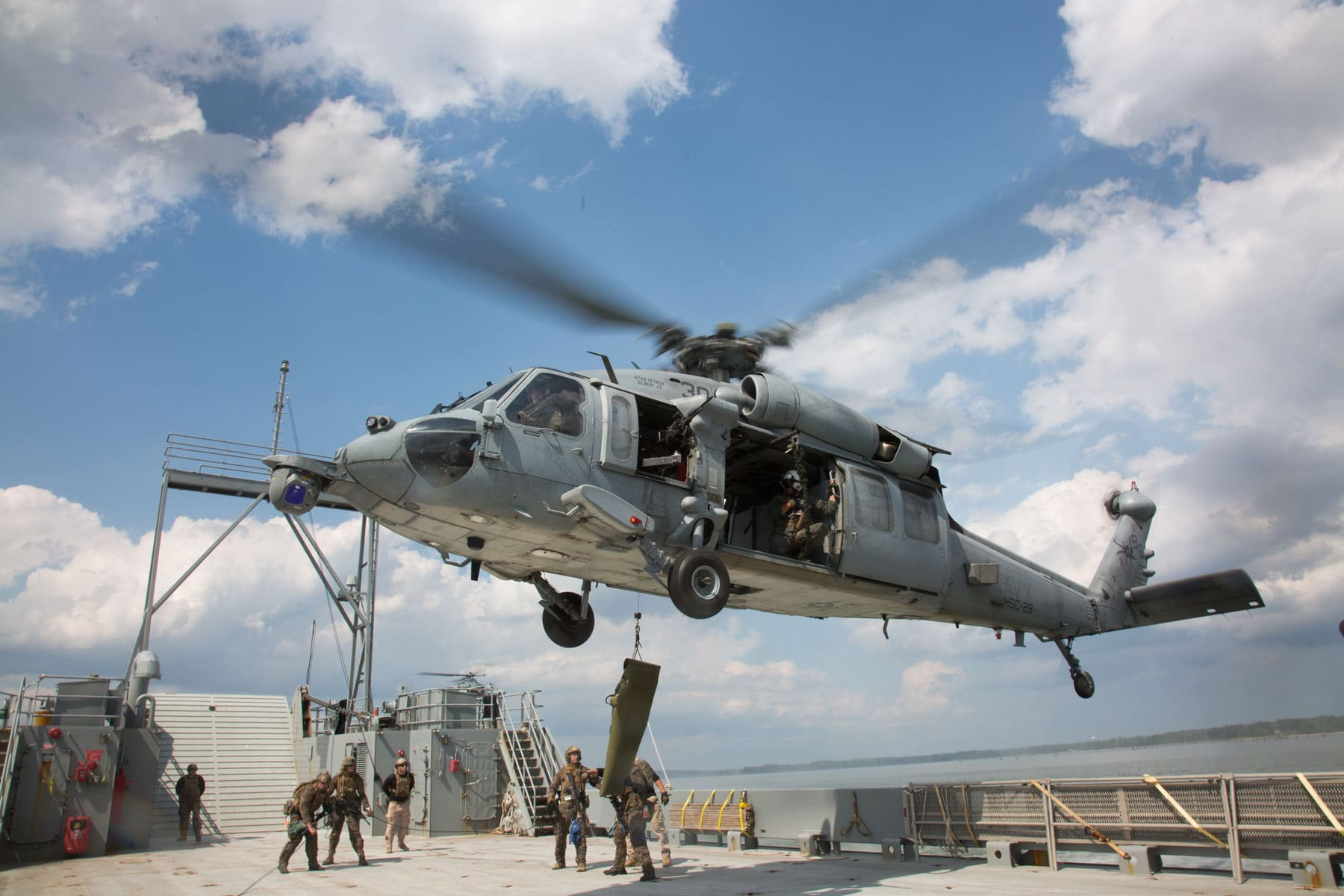 US Marines with the Maritime Raid Force (MRF), 26th Marine Expeditionary Unit (MEU), and Sailors with Helicopter Sea Combat Squadron (HSC) 28 utilize an MH-60S Seahawk to hoist a simulated casualty.