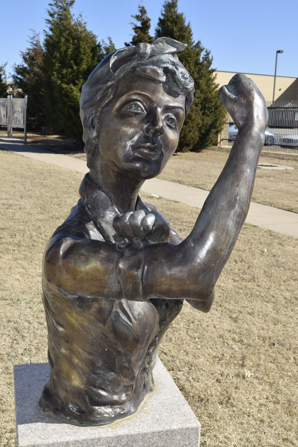 Rosie the Riveter rolls up her sleeve in this bronze bust symbolizing the contributions to the war-effort made during and after World-War II by women in the Charles B. Hall Memorial Air Park at Tinker Air Force Base, Oklahoma.