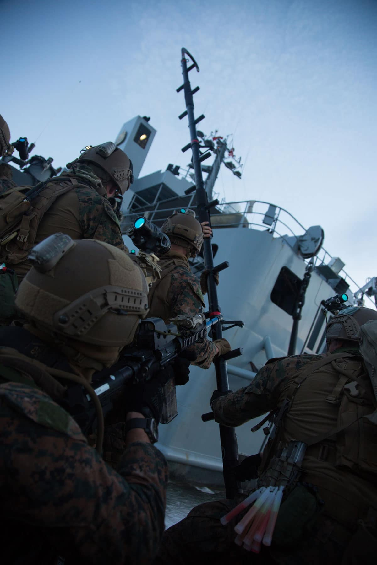 U.S. Marines with the Maritime Raid Force, 26th Marine Expeditionary Unit, employ a ladder during visit, board, search and seizure.
