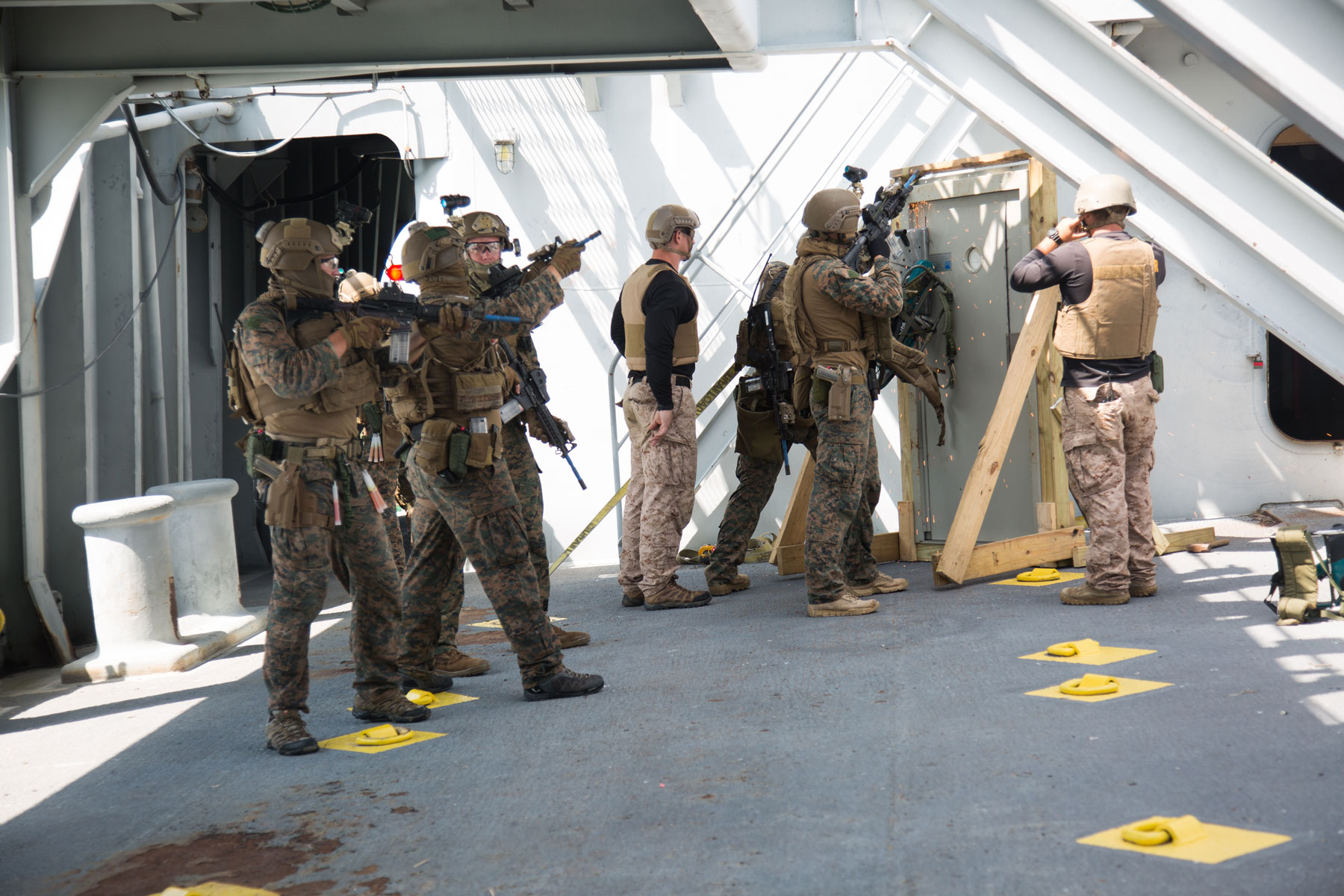 U.S. Marines with the Maritime Raid Force (MRF) operate a circular saw to rehearse breaching techniques.