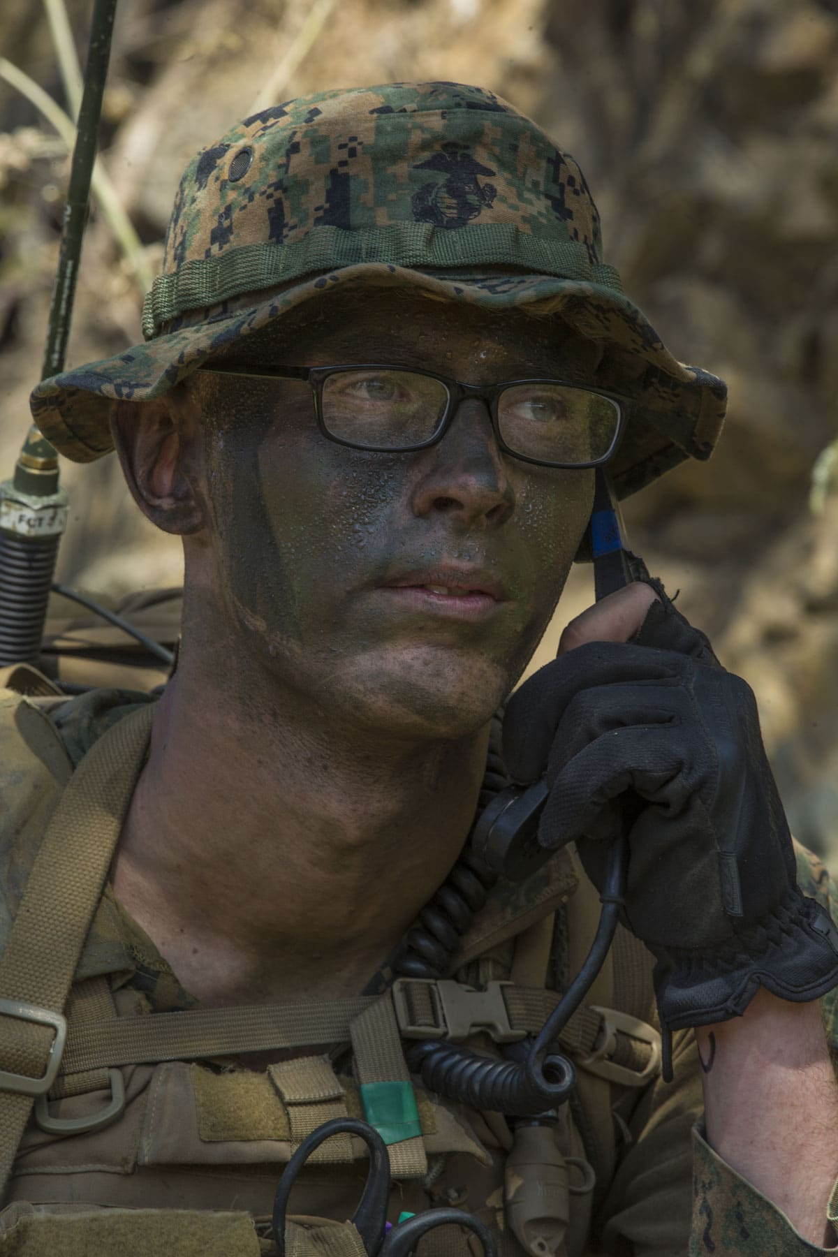 Marine Corps Lance Cpl. Michael Bruce, a Radio Operator, radio checks with fellow squad members during a simulated reconnaissance mission.