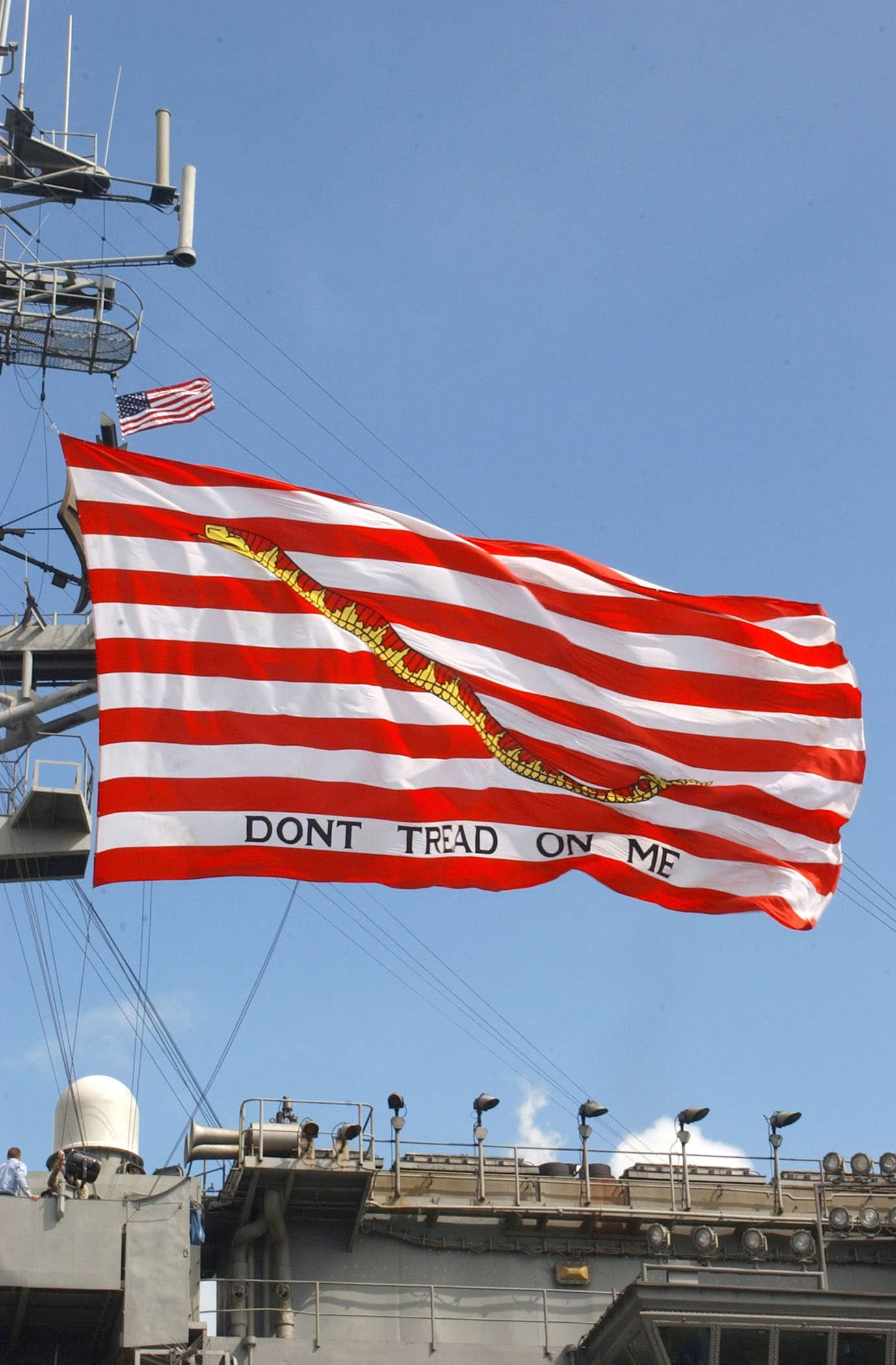 At sea aboard USS Kitty Hawk (CV 63) Feb. 15, 2003 -- The Navy's largest First Navy Jack, with the motto Don't Tread On Me, flies high above USS Kitty Hawk during her transit through the Straits of Malacca.