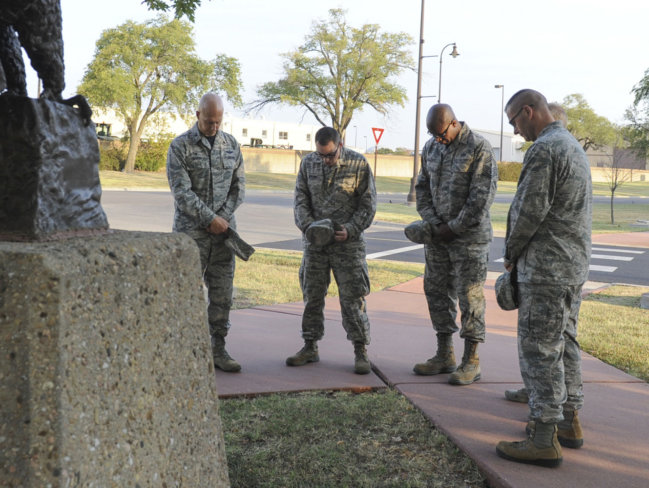 Leadership from the 22nd and 931st Air Refueling Wings pray for prisoners of war and missing service members before a wreath laying ceremony in honor of POW/MIA week at McConnell Air Force Base, Kansas. Currently, there are 82,473 service members MIA.