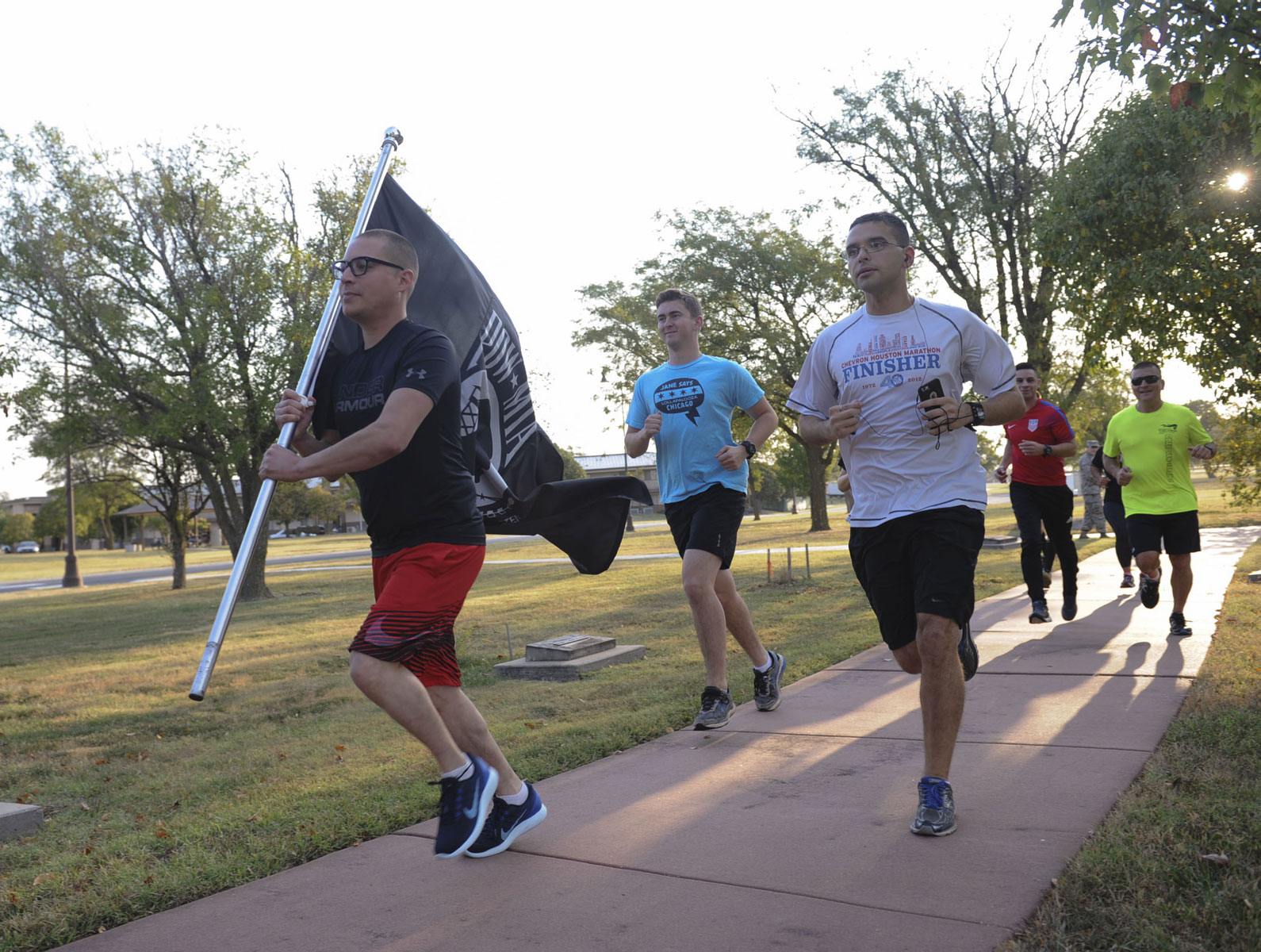 Team McConnell Airmen run with the POW-MIA flag as part of a run/walk relay during POW/MIA week at McConnell Air Force Base, Kansas. In 1979, congress passed a resolution declaring the third Friday in September as POW/MIA Recognition Day.