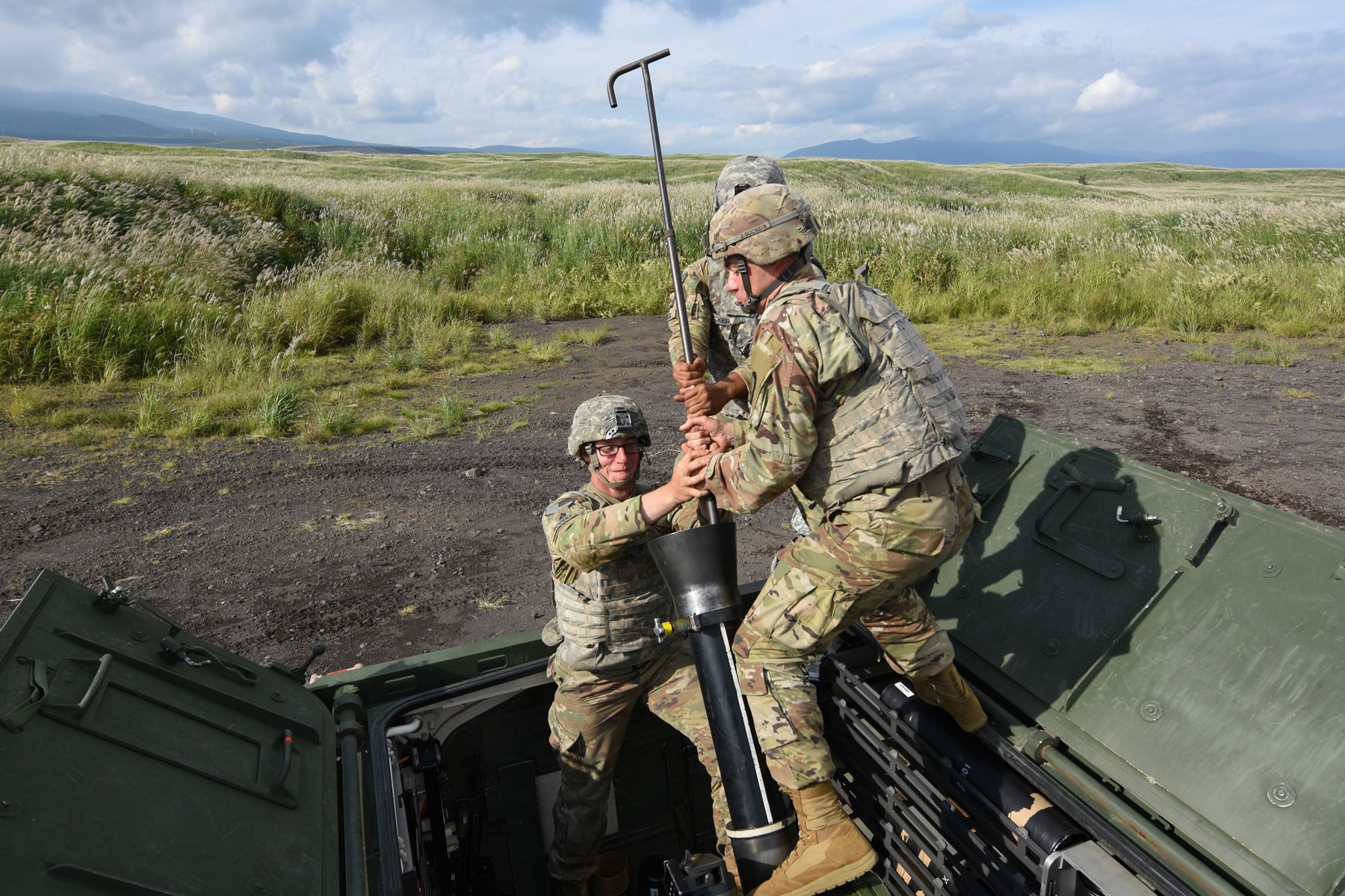 U.S. Army Soldiers assigned to Headquarters, Headquarters Company, 3rd Battalion, 21st Infantry Regiment, 1st Stryker Brigade Combat Team, 25th Infantry Division, clean a RMS6L 120mm mortar system on a M1129 Mortar Carrier between fire missions as part of exercise Orient Shield 2017 at Camp Fuji, Japan.