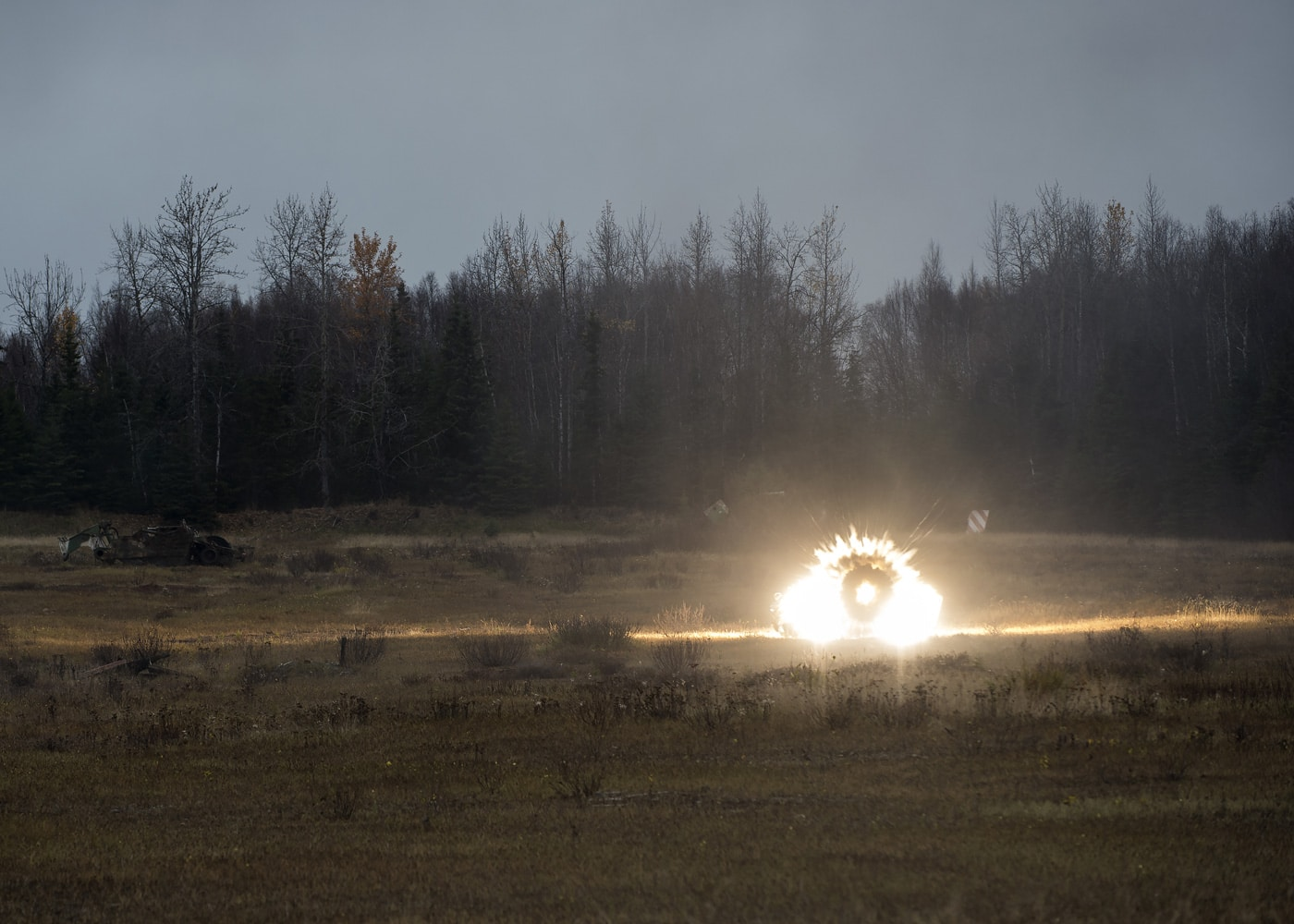 A M136E1 AT4-CS confined space light anti-armor weapon round explodes down range during a live fire on Joint Base Elmendorf-Richardson, Alaska.