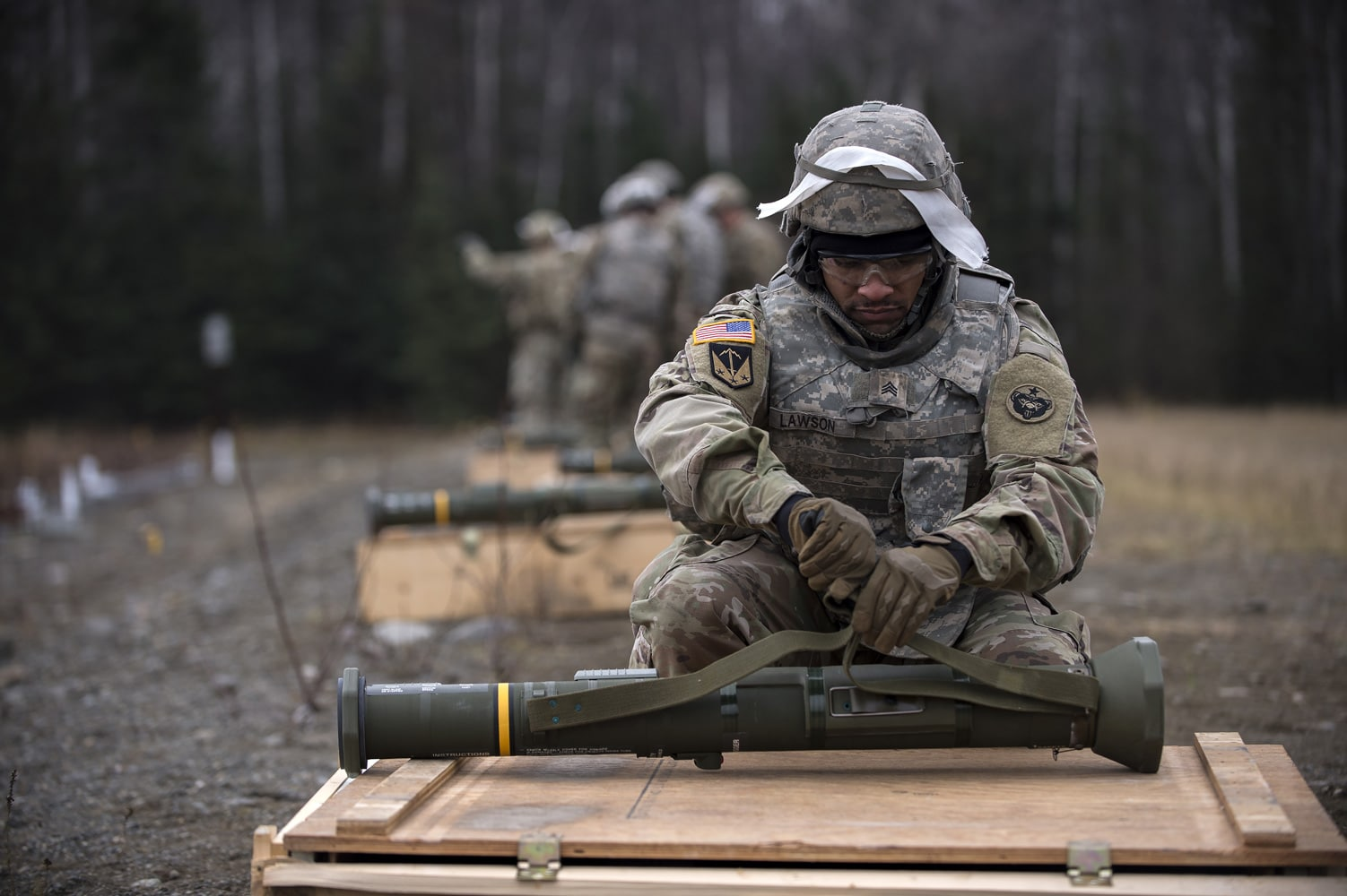 Army Sgt. Derek Lawson, assigned to the 109th Transportation Company, 17th Combat Sustainment Support Battalion, U.S. Army Alaska, prepares a M136E1 AT4-CS confined space light anti-armor weapon for firing at Joint Base Elmendorf-Richardson, Alaska.