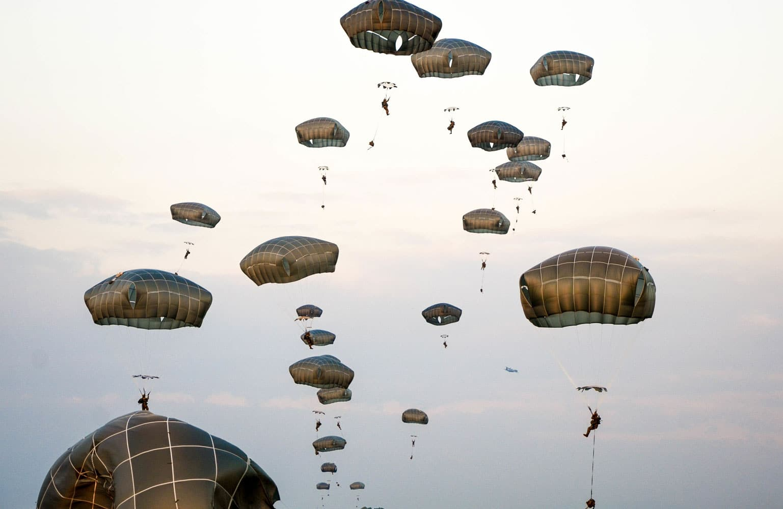 Paratroopers from the 173rd Airborne Brigade exit the C-130 Hercules in an emergency deployment training exercise.